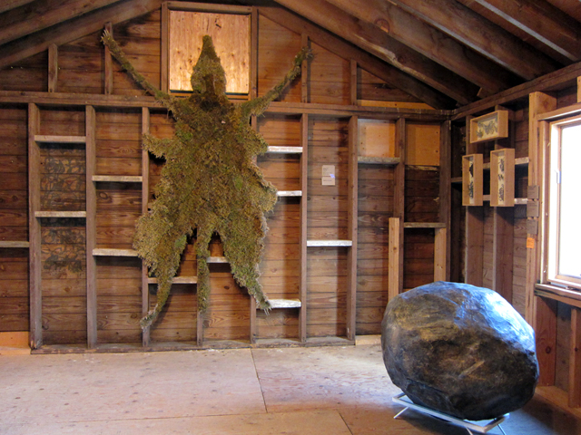 "Markel Uriu, ""The Pelt"" (2013), moss, burlap, thread (left) and MaryKate Maher, ""Scholars Rock"" (2012), resin and steel (right)"