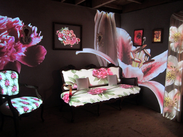 "Carmen Osterlye, ""Den of Blossomy"" (2013), found furniture, two-channel video projection"