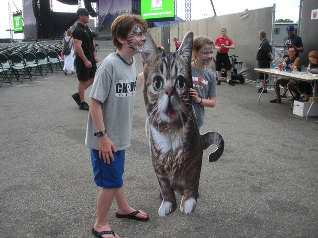 Posing with life-size Lil Bub
