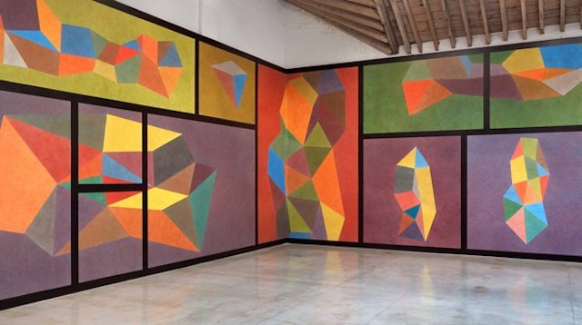"""Sol LeWitt at Paula Cooper Gallery, """"Wall Drawing #564: Complex forms with color ink washes superimposed"""" Photo via New York Times, LeWitt Estate Artists Rights Society (ARS), New York and Paula Cooper Gallery, New York City"""