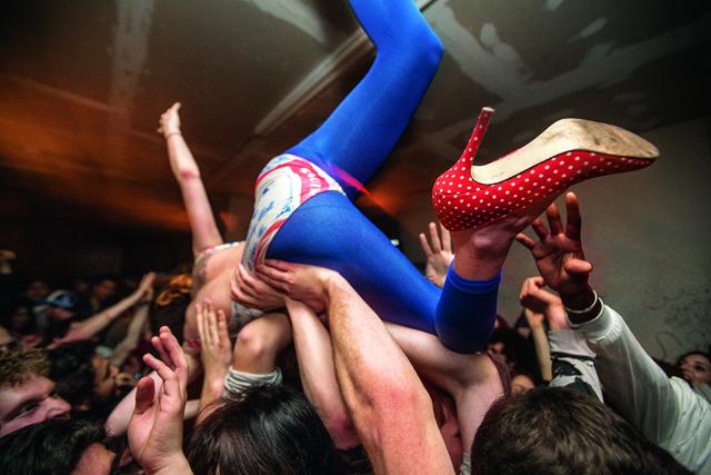 crowd surfing during a Spank Rock show at Bodega, Bushwick, Brooklyn, 2009.