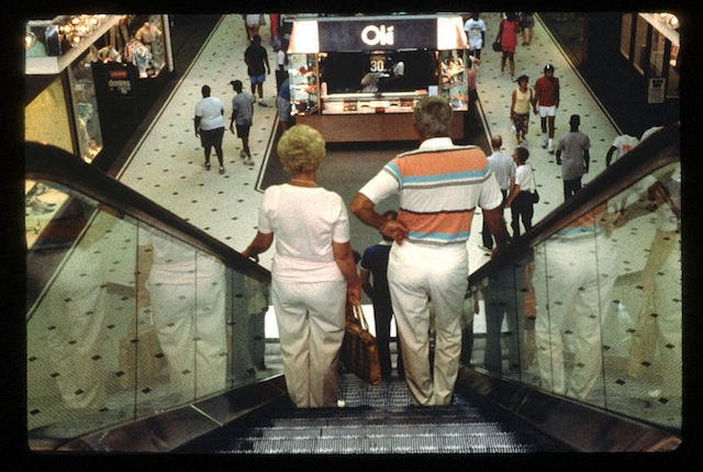 """""""Couple on an Escalator"""" from Michael Galinksy's project """"Malls Across America"""""""