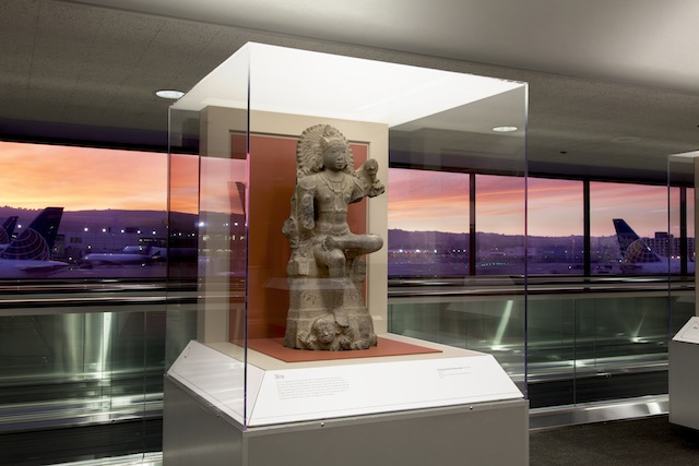 The Hindu Deity Shiva as a divine teacher, a granite sculpture lent by the Asian Art Museum for Deities in Stone: Hindu Sculpture from the Collections of the Asian Art Museum. Image courtesy SFO Museum.