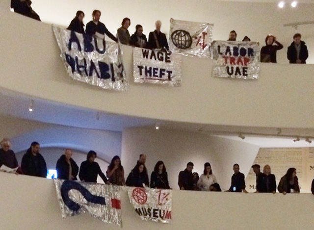 A close-up of some of the banners unfurled during the Saturday, February 22 intervention by G.U.L.F. at the Guggenheim Museum in Manhattan. (photo by the author for Hyperallergic)