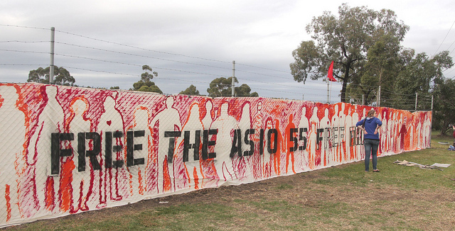 A banner in Melbourne protesting Australia's treatment of refugees and asylum seekers. ASIO stands for Australian Security Intelligence Organisation.