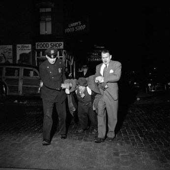 Man being dragged by cops at night, still from John Maloof and Charlie Siskel's 'Finding Vivian Maier' (photo by Vivian Maier) (courtesy the Maloof Collection) (click to enlarge)