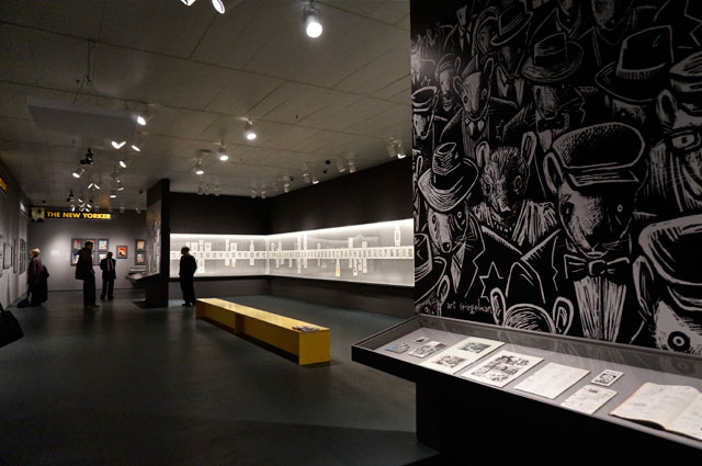 """Installation view, 'Art Spiegelman's Co-Mix"""" at the Jewish Museum, with a case of 'Maus'-related papers and objects on the right; beyond that, the displayed manuscript of 'Maus II'"""