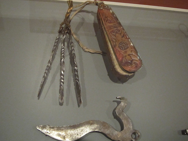 Set of bloodletting instruments with container (20th century), silver, Tibet; Surgical instrument (early 20th century), metal alloy, Central Tibet