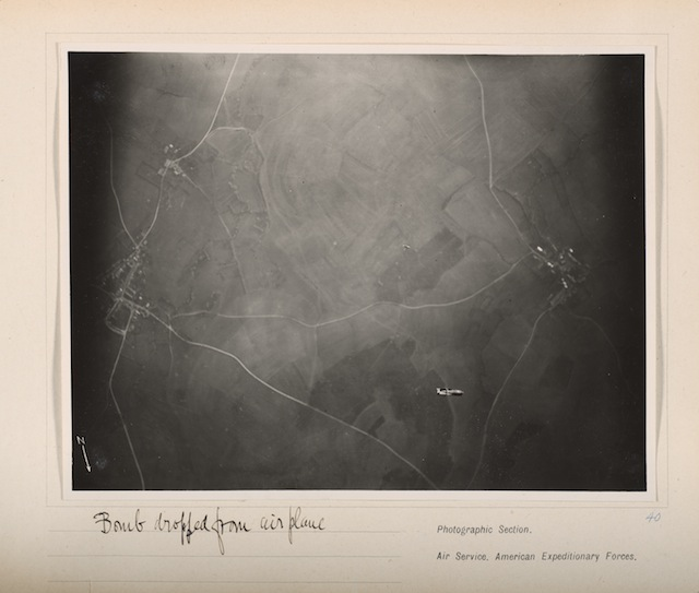 "Edward Steichen, ""Bomb Dropped From Airplane"" (1918), gelatin silver print, from loose-leaf album of aerial photographs from the Photographic Section, Air Service, American Expeditionary Forces, World War I; The Art Institute of Chicago, gift of William Kistler (© 2014 The Estate of Edward Steichen/Artists Rights Society [ARS], New York)"