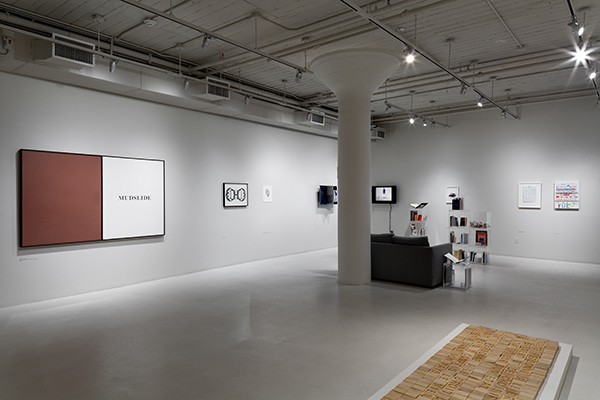 """Installation view, 'Thanks for Writing,' with John Baldessari's """"Prima Facie (Fifth State): Mudslide"""" on left"""