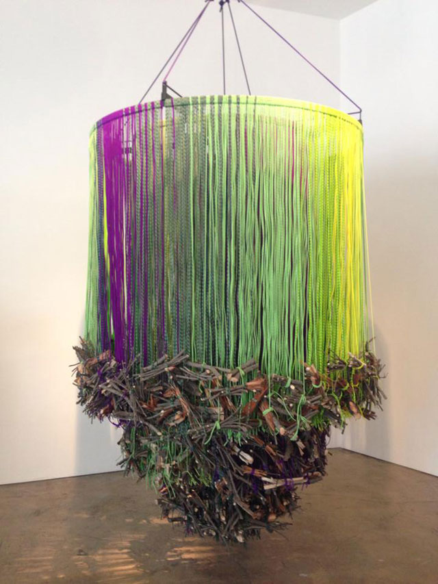 """Andrea Bowers, """"Memorial to the Acadia Woodlands Clear Cut (Green, Violet and Brown)"""" (2014), metal, paracord rope, and wood"""
