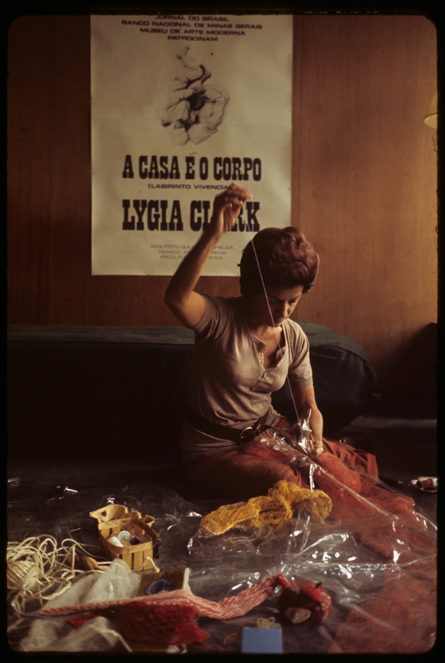 "Lygia Clark in her studio working on ""Arquitetura biológica II"" (Biologic architecture II), Cité internationale des arts, Paris, 1969 (photo by Alécio de Andrade, courtesy Associação Cultural ""O Mundo de Lygia Clark,"" Rio de Janeiro)"