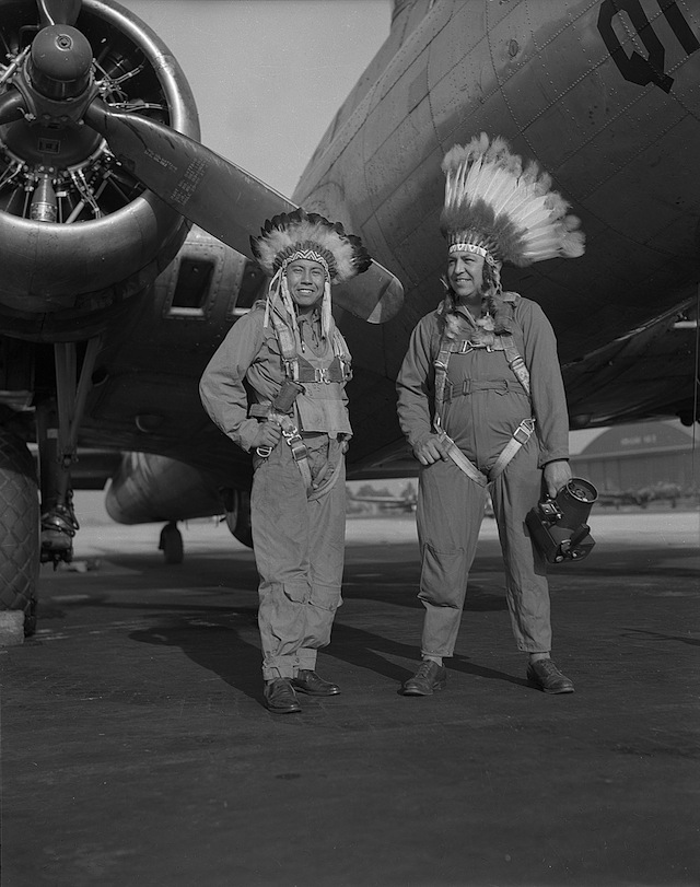 Caption: Gus Palmer (Kiowa, at left), side gunner, and Horace Poolaw (Kiowa), aerial photographer, in front of a B-17 Flying Fortress. MacDill Field, Tampa, Florida, ca. 1944. 45UFL14