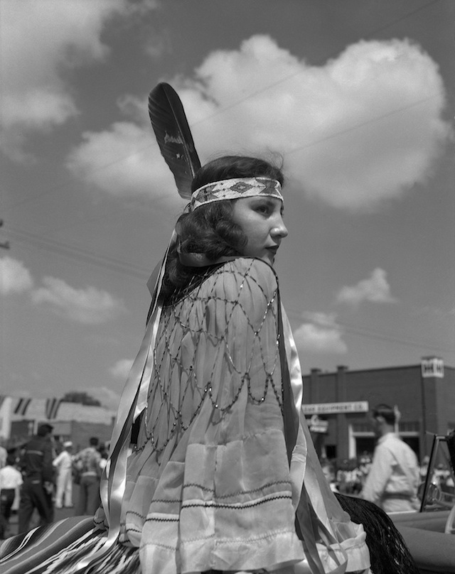 Caption: Eula Mae Narcomey Doonkeen (Seminole) in the American Indian Exposition Parade. Anadarko, Oklahoma, ca. 1952. 45EXCW6