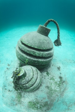 Ticking time bomb sculptures by Jason de Caires Taylor (image courtesy the artist) (click to enlarge)