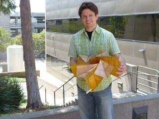 Brian Trease with the solar panel array prototype (photograph courtesy NASA/JPL-Caltech)