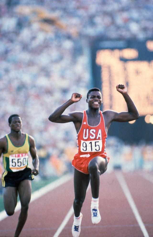 Carl Lewis, who won four gold medals at the LA Olympcs in 100m, 200m, 4 x 100m relay, & long jump (Los Angeles 1984 OG, Athletics, 100m Men - Final, Carl LEWIS (USA) 1st wins. Ray STEWART (JAM).