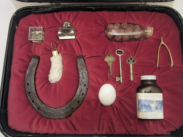 "Jackie Mock, ""Good Luck (For the Road),"" vintage suitcase with good luck charms from around the world"