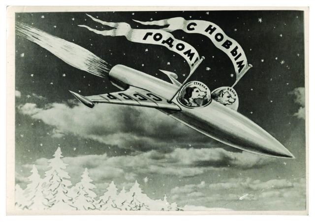 BELKA STRELKA MONTAGE POSTCARD.jpg Postcard, USSR (1960) A postcard showing Belka and Strelka in their rocket by the photomontage artist Sveshnikov. The flags read 'Happy New Year', on the wing of the rocket 'USSR', inside the cockpits 'Strelka', and 'Belka'. © FUEL Publishing
