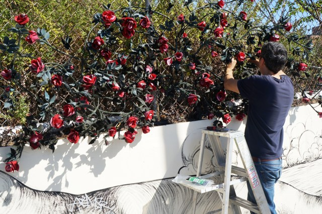 "Carlton Scott Sturgill installing ""Bridge of Flowers"" (photo courtesy Arts Gowanus)"