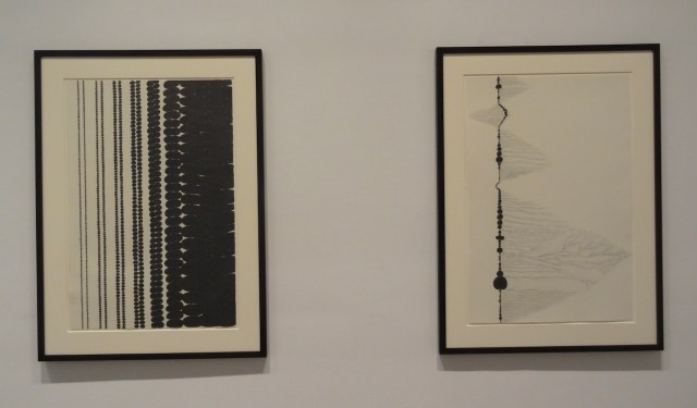 """Installation view of 'Chris Ofili: Night and Day' with """"Afro Margin Eight"""" (2007, at left) and """"Afro Margin Two"""" (2004, at right)"""