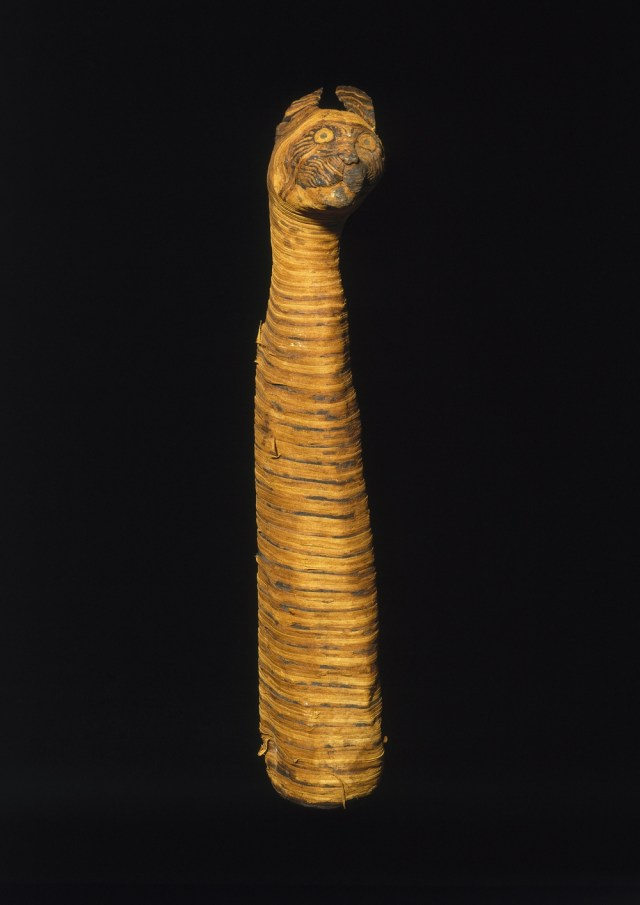 Cat Mummy. From Egypt. Third Intermediate Period to Late Period, 780-390 B.C.E. Linen, animal remains, 23 13/16 x 4 3/4 x 5 1/2 in. (60.5 x 12.1 x 14 cm). Brooklyn Museum; Charles Edwin Wilbour Fund, 37.1988E
