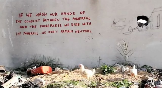 A text-based work by Banksy in Gaza.