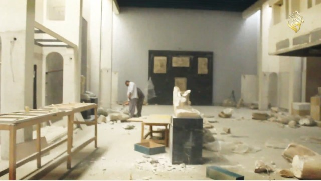 Destructing in the Mosul Museum with some remaining items in the background.