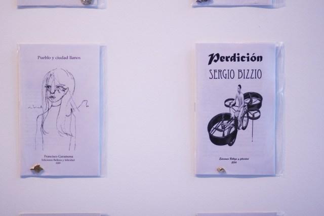 """Francisco Garamona, """"Pueblo y ciudad llanos"""" (Plain people and city). Sergio Bizzio, """"Pedrición"""" (Perdition.) Printer paper, dimensions unavailable."""