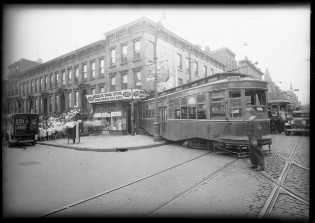 Streetcar that jumped the tracks at Nostrand & Putnam avenues (July 1931) (courtesy New York City Municipal Archives)