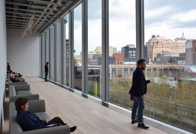 """The view from the other end of the fifth floor, where visitors can sit under Glenn Ligon's """"Rückenfigur"""" (2009) and look out toward the High Line"""