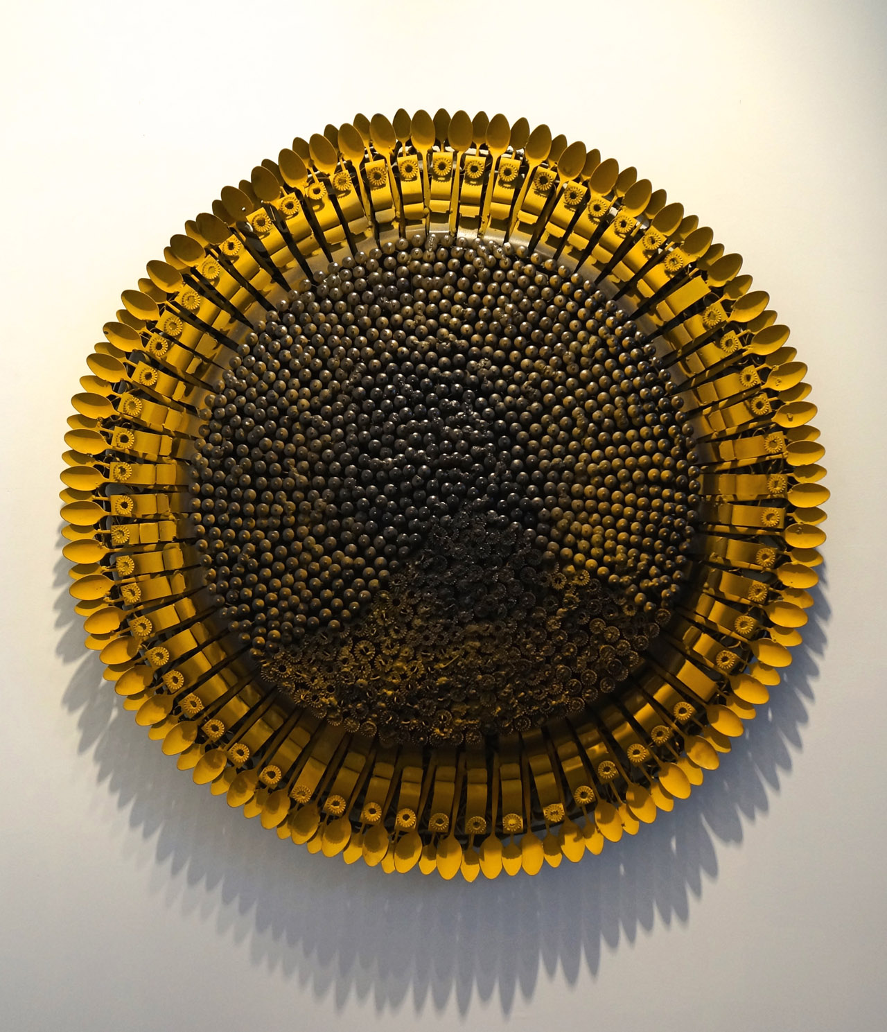 "Olu Amoda, ""Medium Sunflower iii"" (2014), blind revert, steel belt, mild still pipe, 52 x 52 in, at the booth of Art Twenty One"