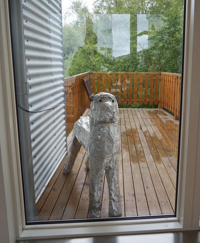 A dog sculpture at the door