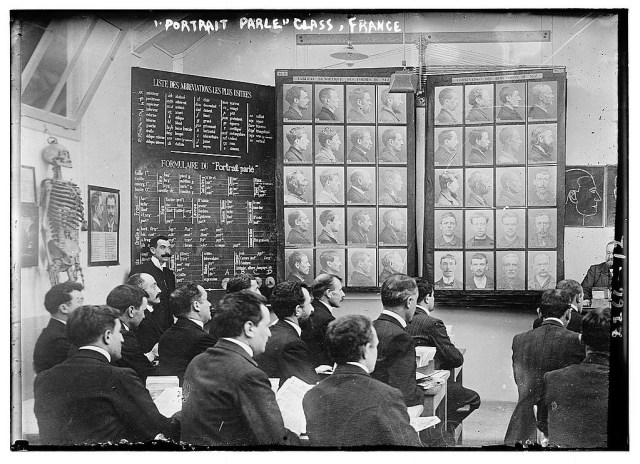 A class in Paris between 1910 and 1915 studying the Bertillon method of criminal identification, developed by the French criminologist Alphonse Bertillon. (photo by Bain News Service, via Wikimedia Commons)
