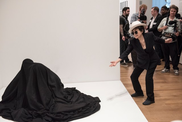 Yoko Ono interacting with people activating Bag Piece (1964), a participatory work in Yoko Ono: One Woman Show, 1960-1971, on view at MoMA, May 17 -September 7, 2015. Photo by Ryan Muir © Yoko Ono
