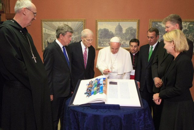 The Pope blesses the Apostles Edition of The Saint John's Bible. On left, Abbot John Klassen, Sen. Blunt and Dr. Billington; on right, Monsignor Mark Miles, Speaker Boehner, SJU President Michael Hemesath and GHR Foundation CEO Amy Goldman. (photo by Heather Reed, Office of the Speaker)
