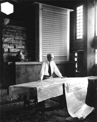 Frank Lloyd Wright stands at the drafting table in his studio at Taliesin, Wisconsin, 1947, photographed by Pedro E. Guerrero (© 2015 Pedro E. Guerrero Archives)