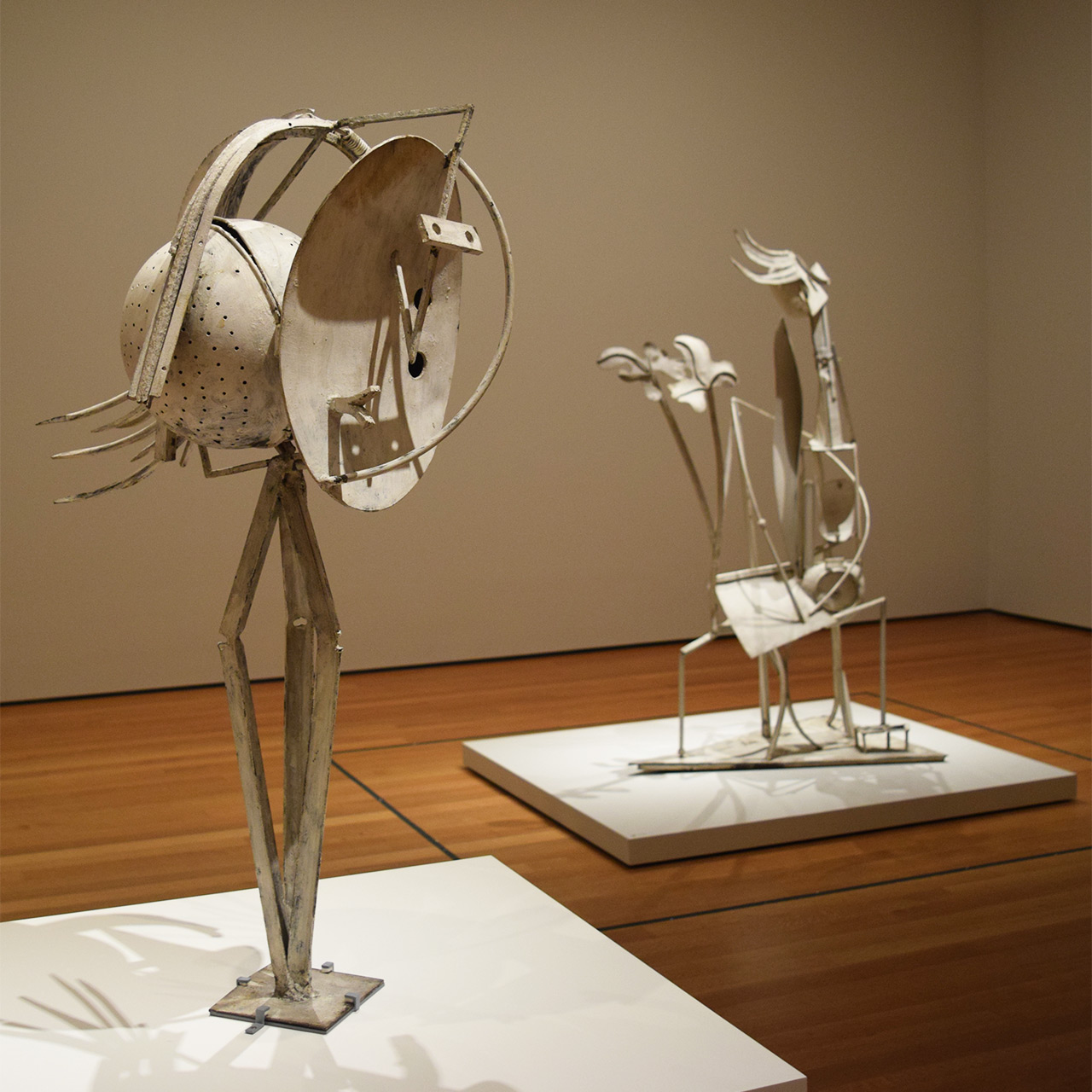 "Installation view of 'Picasso Sculpture' at the Museum of Modern Art with Pablo Picasso's ""Head of a Woman"" (1929–30) at left and ""Woman in the Garden"" (1929–30) at right"
