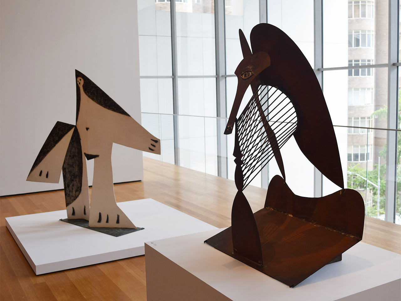 "Installation view of 'Picasso Sculpture' at the Museum of Modern Art with Pablo Picasso's ""Woman with Outstretched Arms"" (1961) at left and the exhibition's latest work, ""Maquette for Richard J. Daley Center Sculpture"" (1964), at right"