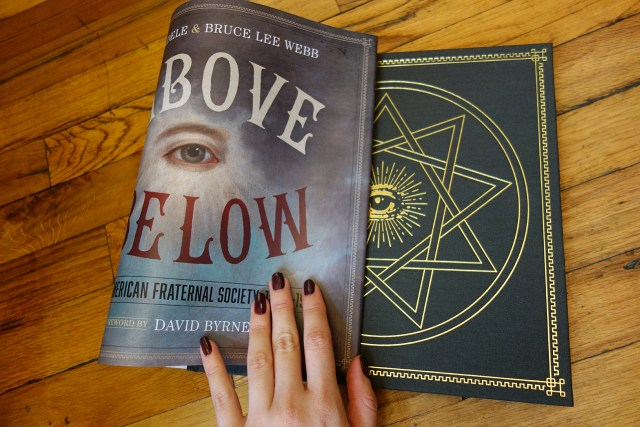All seeing eye hidden behind the dust jacket of 'As Above So Below' (photo of the book for Hyperallergic)