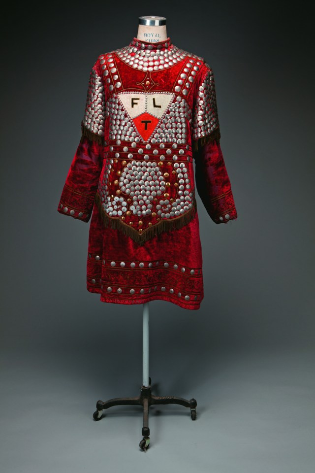 Odd Fellows Master at Arms costume, ca. 1900–1920 C. E. Ward, New London, Ohio Red velvet tunic and leggings with nickel decorative disks, matching shoes and hat Webb Collection