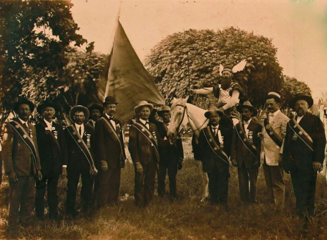 Sons of Hermann lodge members dressed for a parade, Shiner, Texas (1909). The man on horseback is wearing a Thor costume. (courtesy Webb Collection)