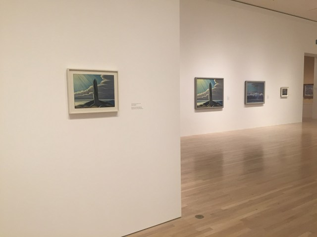 """Installation view, 'The Idea of North: The Paintings of Lawren Harris,' featuring """"The Old Stump, Lake Superior"""" (1926) at left and """"North Shore Lake Superior"""" (1926) in the middle (click to enlarge)"""
