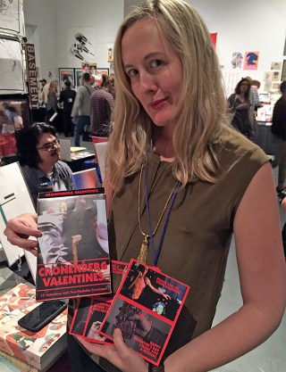 Samantha Culp shows off her David Cronenberg Valentines gift box set at the New Territories booth.