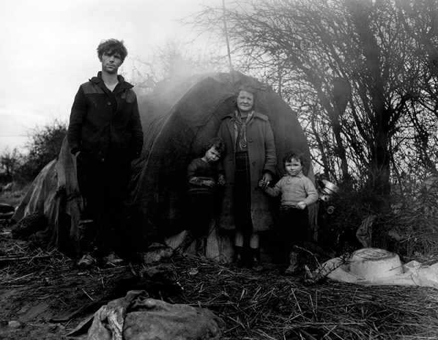 """Wendy Snyder MacNeil, """"Untitled [Young man, old woman and two children standing outside a tent]"""" (1968–69), from the series 'Irish Tinkers,' gelatin silver print, Wendy Snyder MacNeil Archive, Ryerson Image Centre"""
