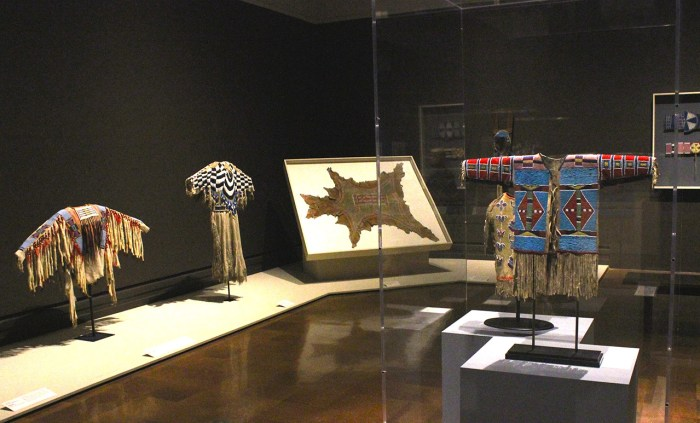 Installation view, 'Indigenous Beauty: Masterworks of American Indian Art from the Diker Collection' at the Toledo Museum of Art, showing garments and domestic objects from the Plains and Plateau region (all photos by the author for Hyperallergic unless otherwise noted)