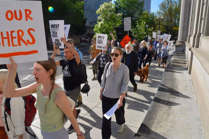 Students and faculty marching in protest at the Pacific Northwest College of Art in Portland, Oregon