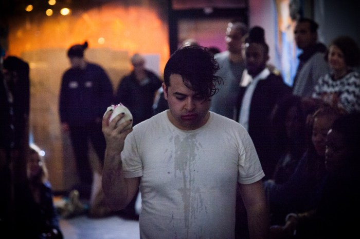 Mercado working his way through a white onion. Photo by Gregory Paul