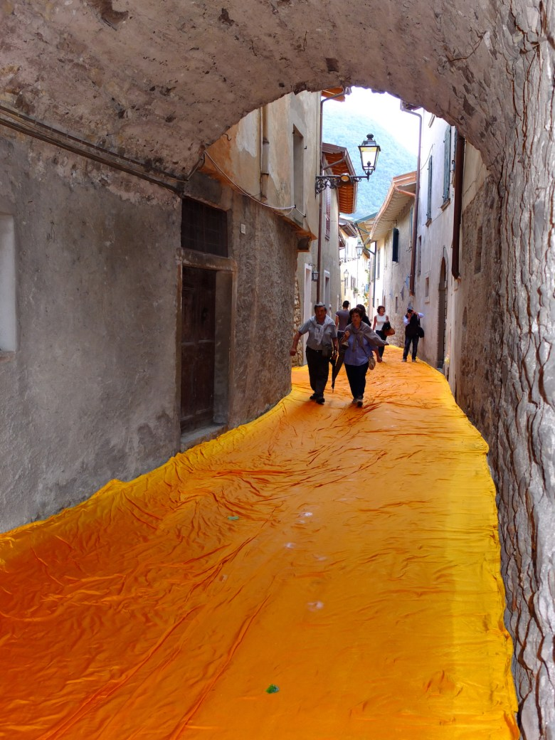 The Floating Piers, Lake Iseo, Italy, 2014-16 The fabric-covered streets of Sulzano Photo: Wolfgang Volz © 2016 Christo