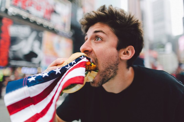 Artist eats American flag (image via Facebook)